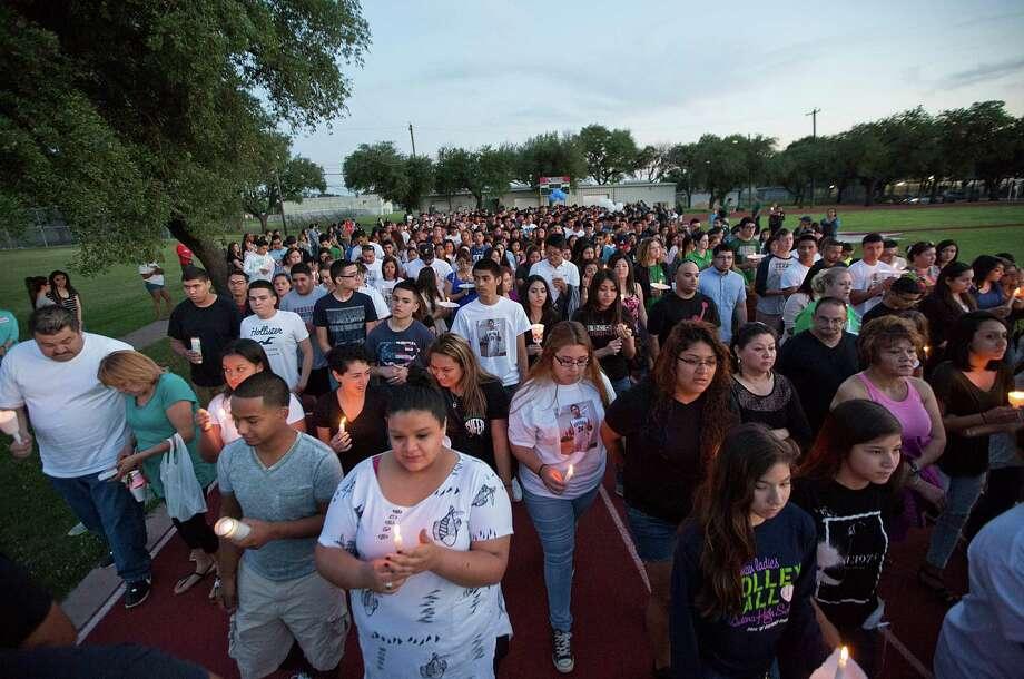 Sunday's candlelight vigil ended with the hundreds of attendees walking around the Pasadena High School track where Eric Medina Jr. collapsed Friday. Photo: Thomas B. Shea, Freelance / © 2015 Thomas B. Shea