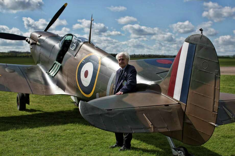 World War II Spitfire pilot Ken Wilkinson poses for a photograph next to a restored Vickers Supermarine Spitfire Mk.1A on April 27, 2015 at Imperial War Museum Duxford in Cambridge, England. The Spitfire, one of the last of its kind remaining, is due to be auctioned for charity on 9 July 2015 and is expected to fetch between 1.5 - 2.5 million GBP (2.25 - 3.8 million USD)Go here for details of the auction. Photo: Carl Court, Getty Images / 2015 Getty Images