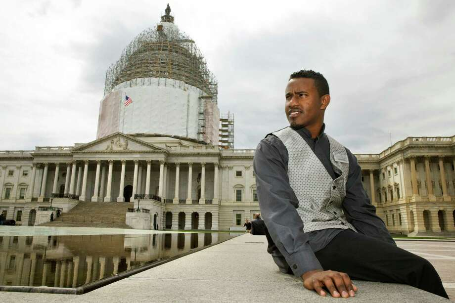 Abraham Tesfahun, 21, works in food service at the Senate and makes $10.70 an hour. Photo: Jacquelyn Martin /Associated Press / AP