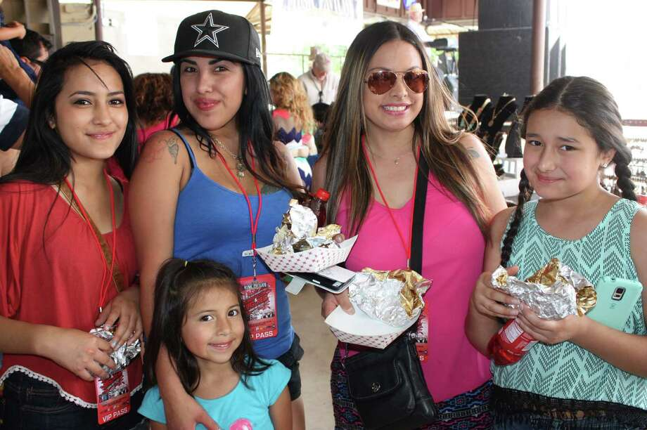 Fans of two San Antonio favorites chow down at the fifth annual Barbacoa & Big Red Festival at the R&J Music Pavilion on the South Side on Sunday, May 3, 2015. Photo: Jennifer A. Luna/For MySA.com