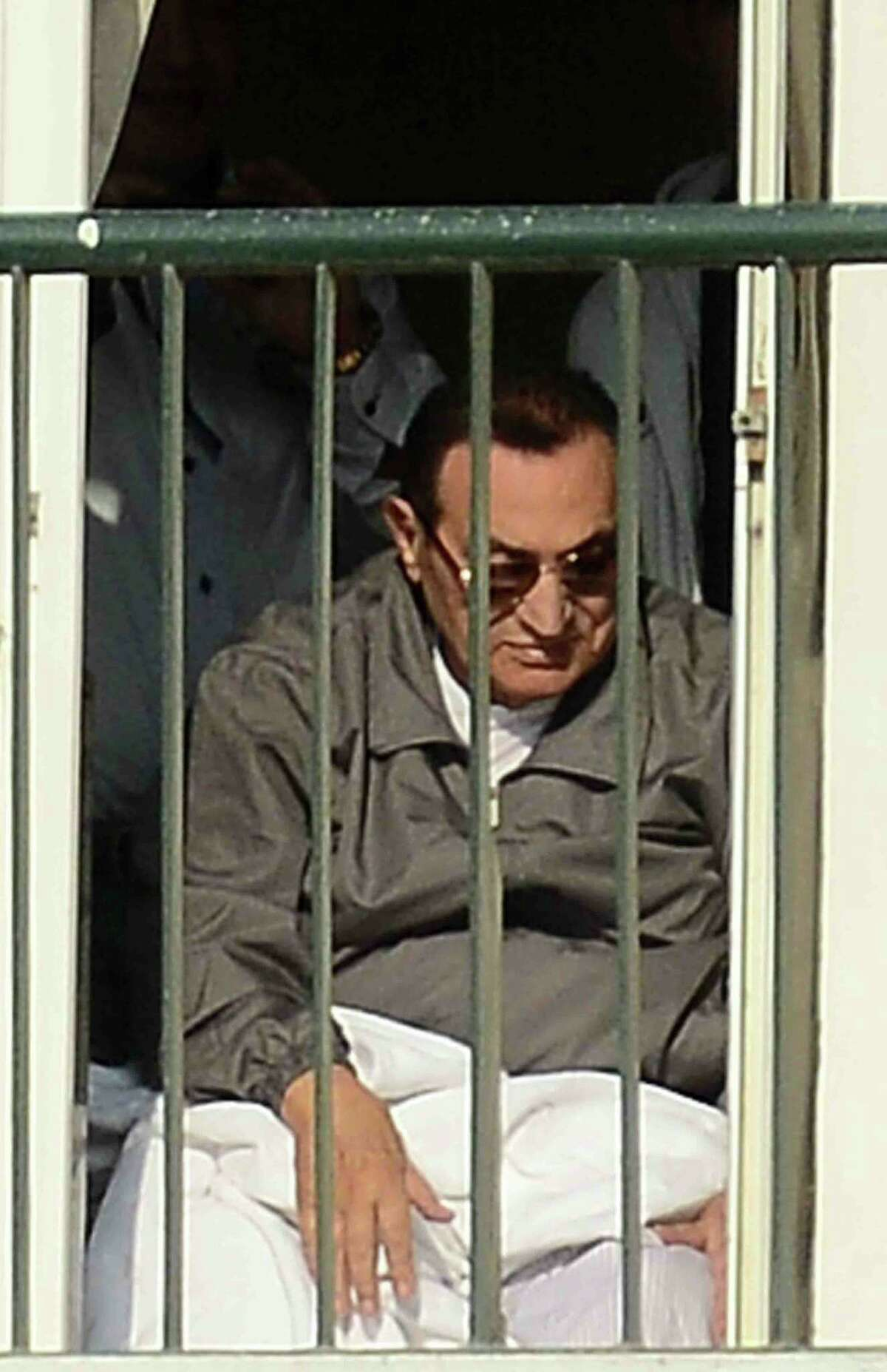 Egypt's former president Hosni Mubarak sits in his chair at the door leading to the balcony of his room at the Maadi military hospital in Cairo on November 29, 2014 after a court dismissed a murder charge against the ousted leader over the deaths of protesters during a 2011 uprising that ended the former strongman's decades-long rule. The court also acquitted Mubarak of a corruption charge, but he will remain in prison because he is serving a three-year sentence in a separate corruption case. AFP PHOTO/AL-WATAN NEWSPAPER/MOHAMED NABILMOHAMED NABIL/AFP/Getty Images
