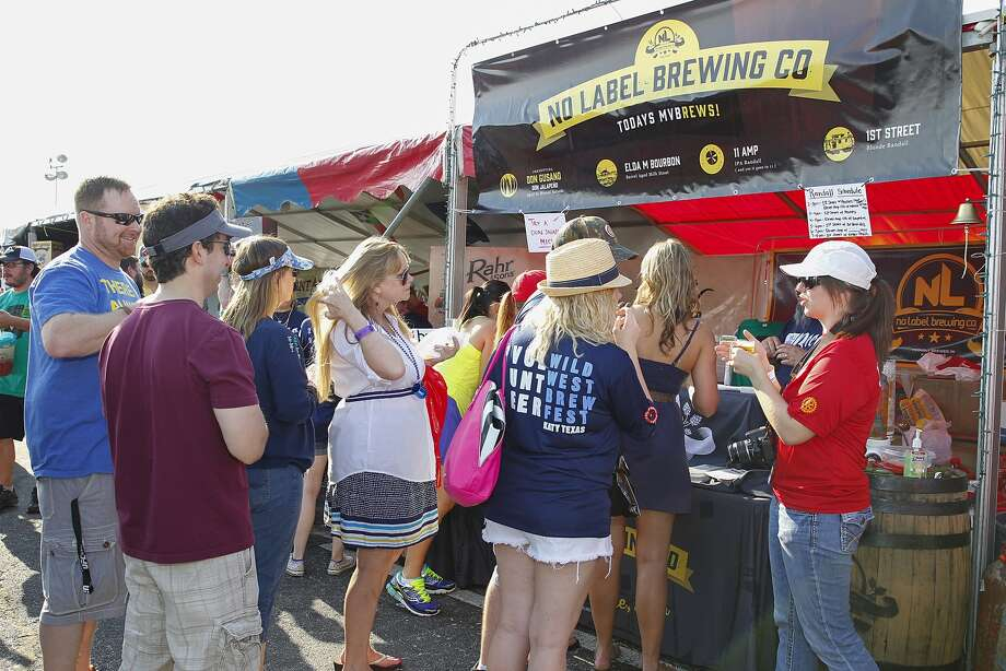 Patrons stand in line to sample beers from Katy's own No Label Brewing Co. at the Wild West Brew Fest held at Katy Mills mall on May 2. Photo: Diana L. Porter, For The Chronicle / © Diana L. Porter