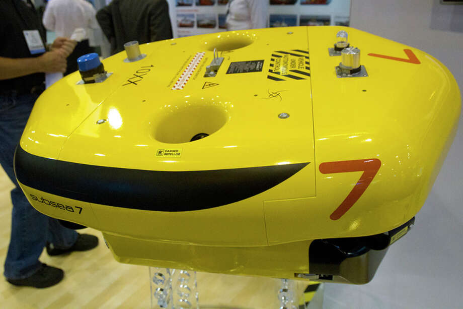Drones are all the rage in the military world right now, and the energy industry is slowly embracing the technology. This drone can autonomously inspect subsea systems. Photo: Cody Duty, Houston Chronicle / © 2013 Houston Chronicle