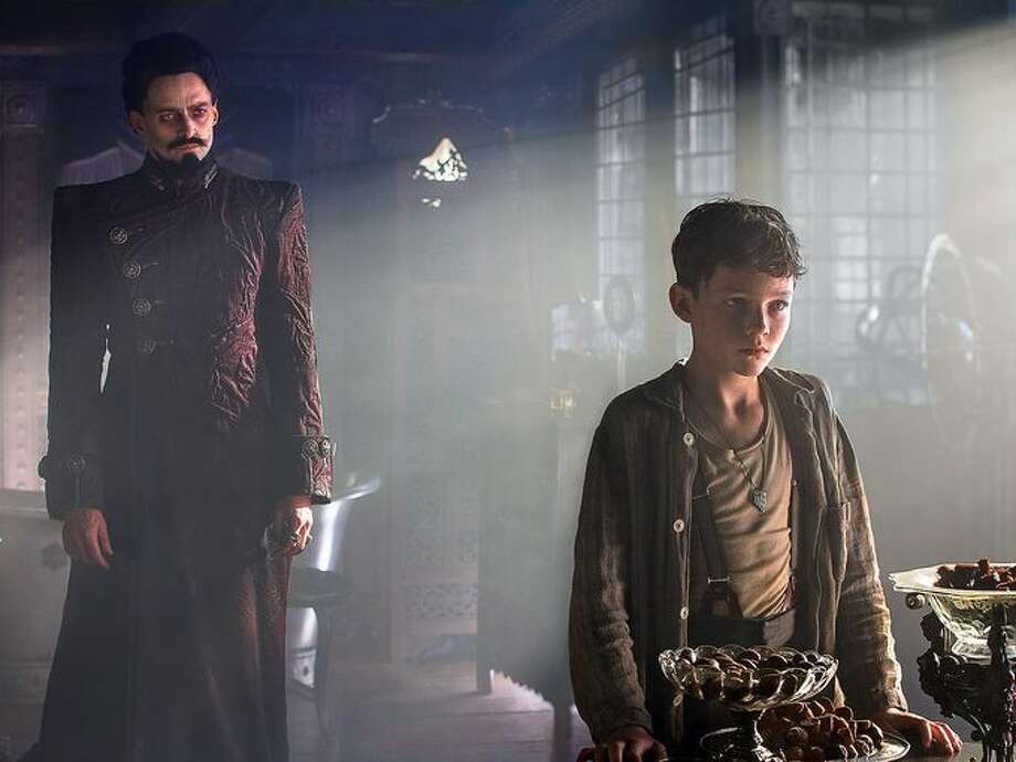 "In the new film ""Pan"" Levi Miller plays a 12-year-old orphan named Peter who gets whisked away to Neverland. Hugh Jackman plays Blackbeard the pirate. Photo: Courtesy Movie Studios"