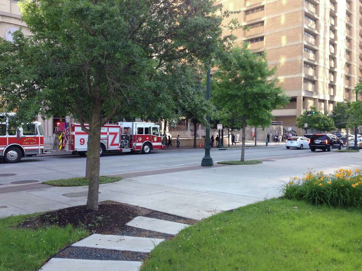 Houston fire crews at the Harris County Civil Courthouse in downtown Houston on May 4, 2015. A bomb squad was at the scene investigating a suspicious package.
