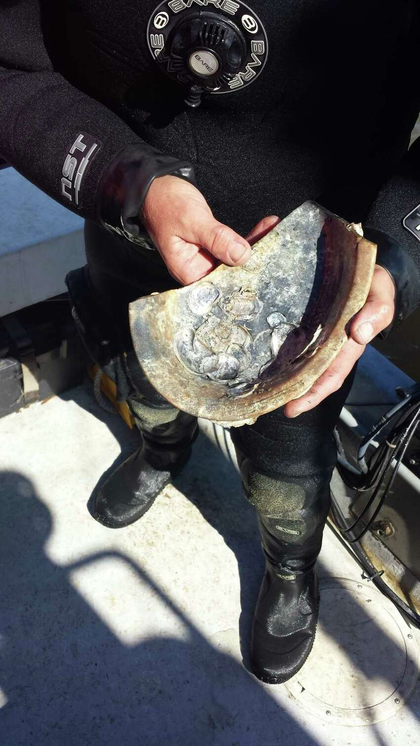 Marine archaeologist Jim Duff holds an ironstone serving dish recovered from the CSS Georgia.