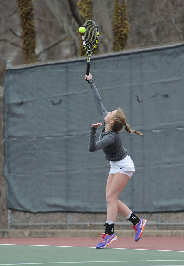 Alex Collins of Staples hits during her match against Maggie Glynn of Greenwich in the girls high school tennis match between Greenwich High School and Staples High School at Greenwich, Conn., Thursday, April 9, 2015. Photo: Bob Luckey / Greenwich Time