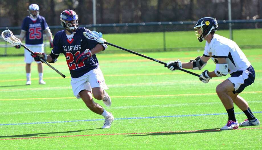 GFA's Isaac Manton, left, sprints toward the Cheshire Academy goal. Manton had one goal in the team's 8-7 overtime victory. Photo: Contributed Photo / Westport News Contributed