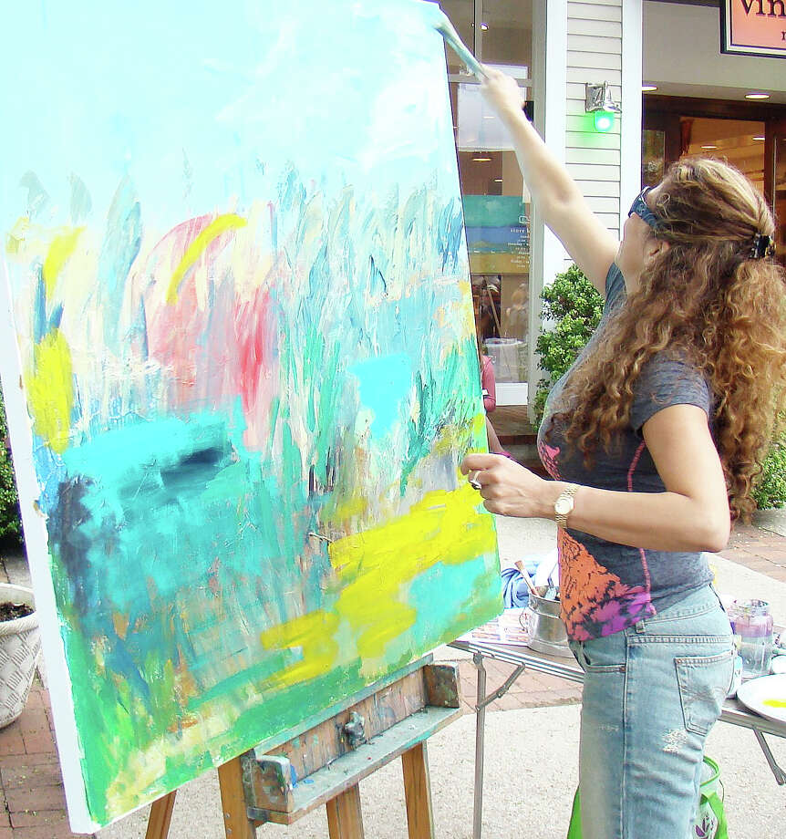 Local artist Sholeh Janati demonstrated her painting technique at a previous Art About Town opening night street party. Artists, musicians, dancers and street performers will line Main Street for the event May 21 from 5:30-8:30 p.m. Photo: Contributed Photo / Westport News
