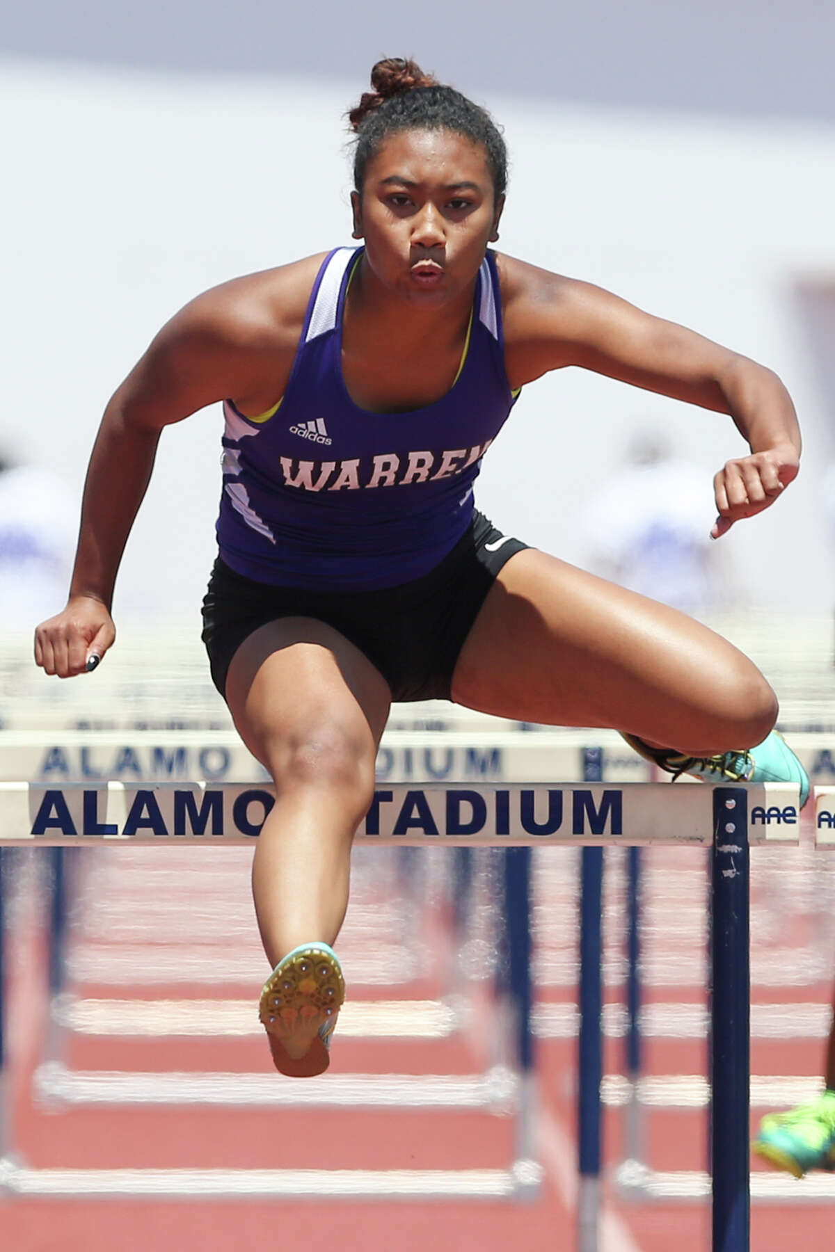 Warren's Jerica Love clears the final hurdle of the 6A 100-meter hurdles during the Region IV-5A and Region IV-6A Track and Field meet at Alamo Stadium on Saturday, May 2, 2015. Love won the event with a time of 14.84 seconds. MARVIN PFEIFFER/ mpfeiffer@express-news.net
