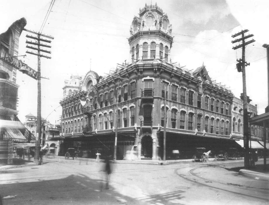 The Dullnig Store at Commerce and Alamo Streets is shown in this undated photo. Today, minus the cupolas, it's the Riverwalk Vista Hotel. Photo: Courtesy Photo