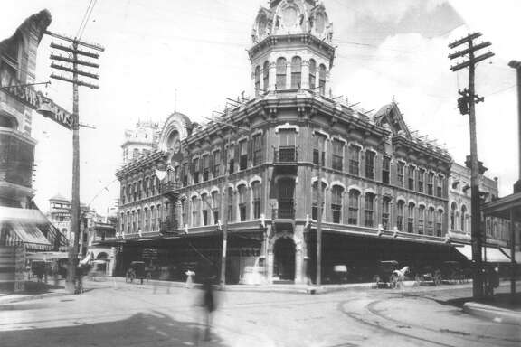 The Dullnig Store at Commerce and Alamo Streets is shown in this undated photo. Today, minus the cupolas, it's the Riverwalk Vista Hotel.