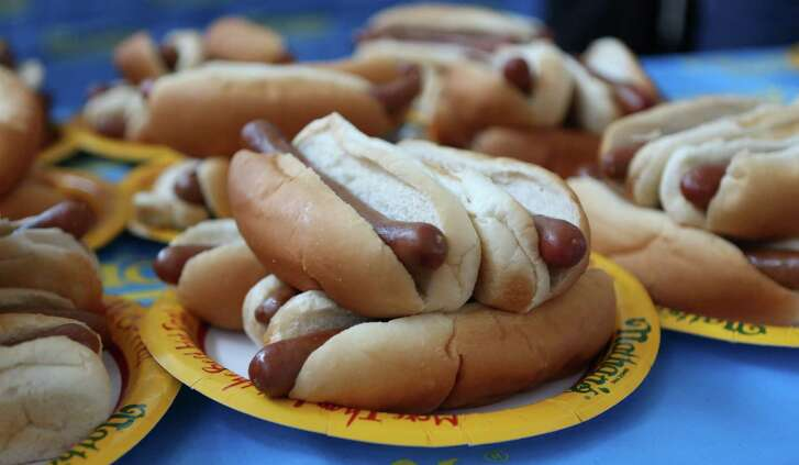 The top male and female finishers in the Houston event will qualify for a seat at the Nathan's Famous Fourth of July International Hot Dog-Eating Contest on Saturday, May 2, 2015, in Houston. Major League Eating and Memorial City host the regional qualifier. ( Mayra Beltran / Houston Chronicle )
