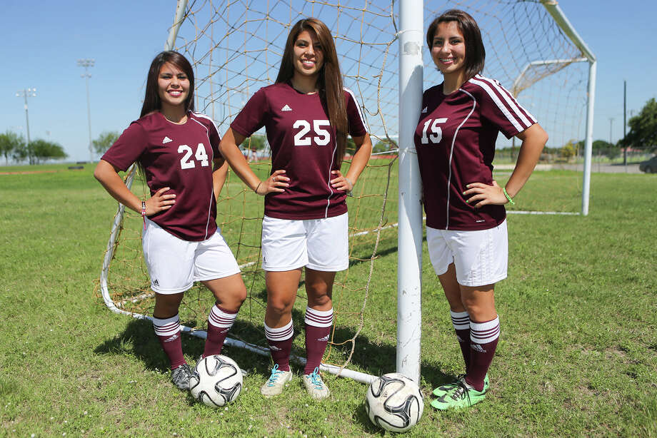 Highlands girls soccer standouts Marilisa (from left), 18, Nathalia, 18, and Catalina Canizalez, 14, say they have enjoyed their season together. Photo: Marvin Pfeiffer /San Antonio Express-News / Express-News 2015