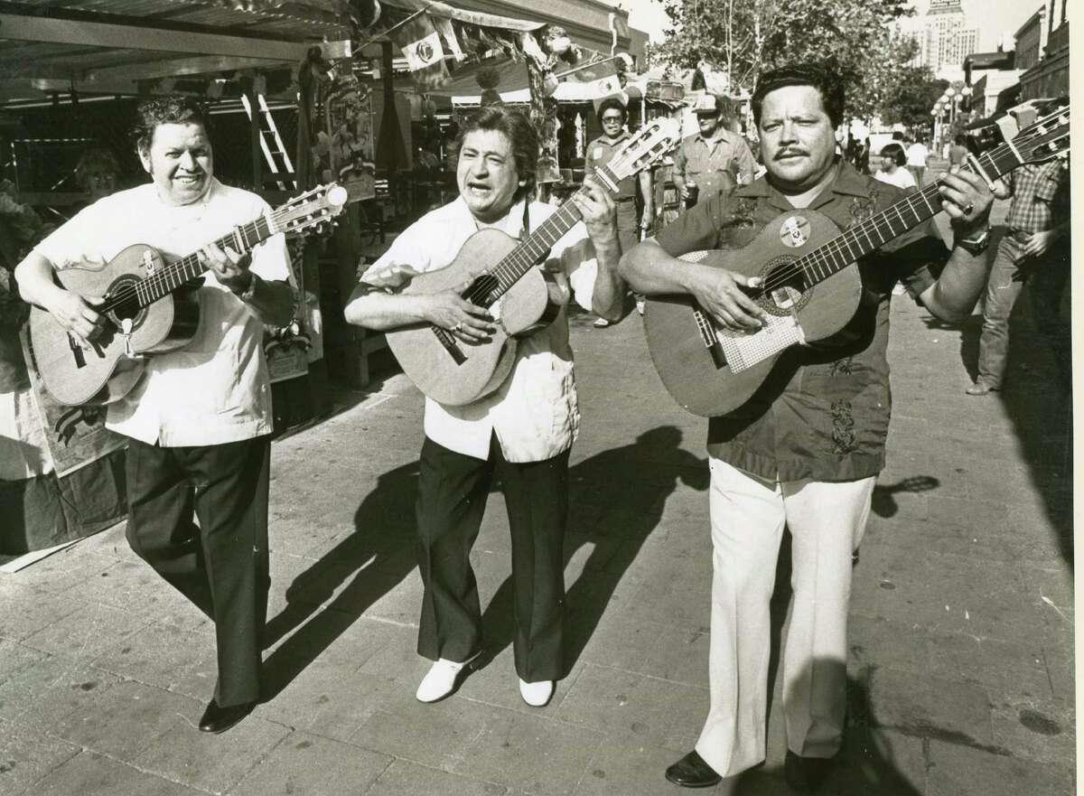 Romelio Alcoser, Jose Chato and Manuel Pena - Los Comadres-entertain El Mercado in 1983.