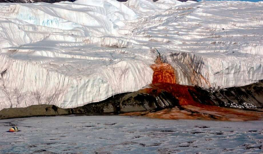 The McMurdo Dry Valleys of Antarctica are home to the Blood Falls, a red ooze that shines bright against the desolate surface. Even though iron oxide is responsible for the hue, analysis has shown that the feature does contain strange bacterial life.  Photo: Post, Washington Post