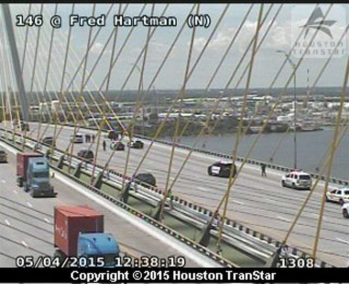 Traffic was slowed Monday on the Fred Hartman Bridge above the Houston Ship Channel while authorities tried to coax a man away from the railing.