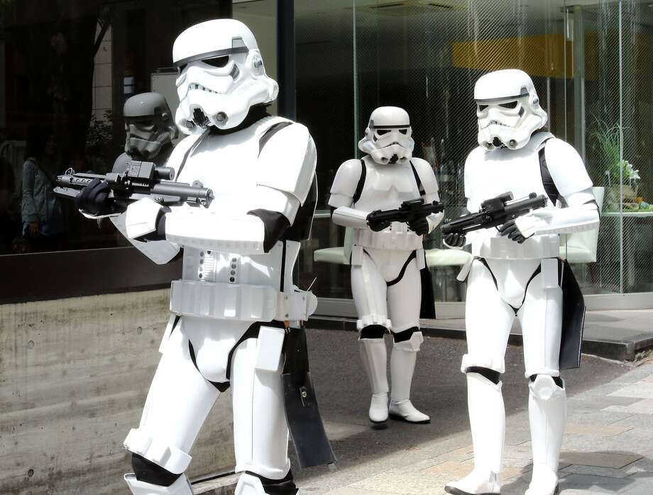 "Storm Troopers pose at a toy shop for the promotion of the Star Wars goods in Tokyo on May 4, 2015. May 4th is called the ""Star Wars Day"" among Star Wars fans as the famous phrase ""May the Force be with you"" in the movie sounds like ""May the 4th be with you"".  AFP PHOTO / Yoshikazu TSUNOYOSHIKAZU TSUNO/AFP/Getty Images Photo: Yoshikazu Tsuno, AFP / Getty Images"