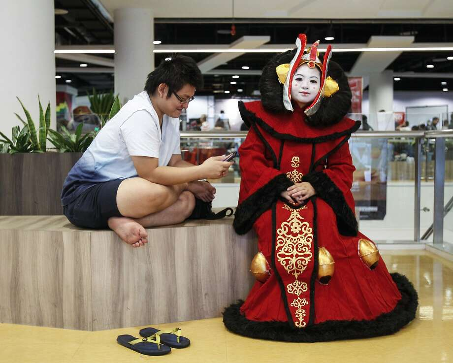 "Star Wars fan Michelle Chee, 32, right, dressed up as Padme Amidala has a rest at a Star Wars Day gathering in a mall downtown Kuala Lumpur, Malaysia, Saturday, May 2, 2015. Star Wars Day is observed by fans globally on May 4 with a slight change in the iconic catchphrase; from ""May the Force be with you"" to ""May the Fourth be with you"". Photo: Joshua Paul, Associated Press"