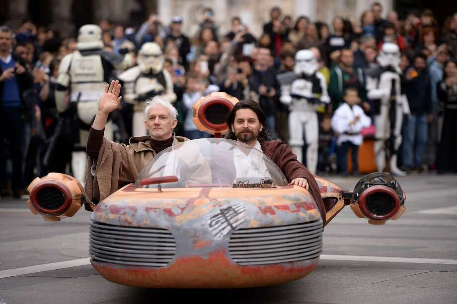 """Cosplayers dressed """"Star Wars"""" characters Obi Wan Kenobi and Anakin Skywalker attend a Star Wars Day event in Milan on May 3, 2015. Photo: Filippo Monteforte, AFP / Getty Images"""