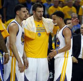 Golden State Warriors' Stephen Curry, David Lee and Klay Thompson after Warriors' 101-86 win over Memphis Grizzlies during Game 1 of NBA Playoffs' Western Conference Semifinals in Oakland, Calif., on Sunday, May 3, 2015.