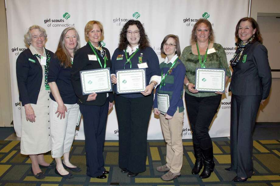 Caroline Sloat, President of the Board of Directors at GSOFCT, poses with Girl Scouts of the USA Volunteer of Excellence Award winners Morgan Tensen- New Canaan Service Unit, Carol Ploch-Maiolo- Ridgefield Service Unit, Catherine Fedorchek-Newtown Service Unit, Barbara Koteen- Norwalk Service Unit and Kerilynn Lewis-Nipmuc Service Unit. At far right is Mary Barneby, CEO of GSOFCT. Photo: Contributed Photo / New Canaan News