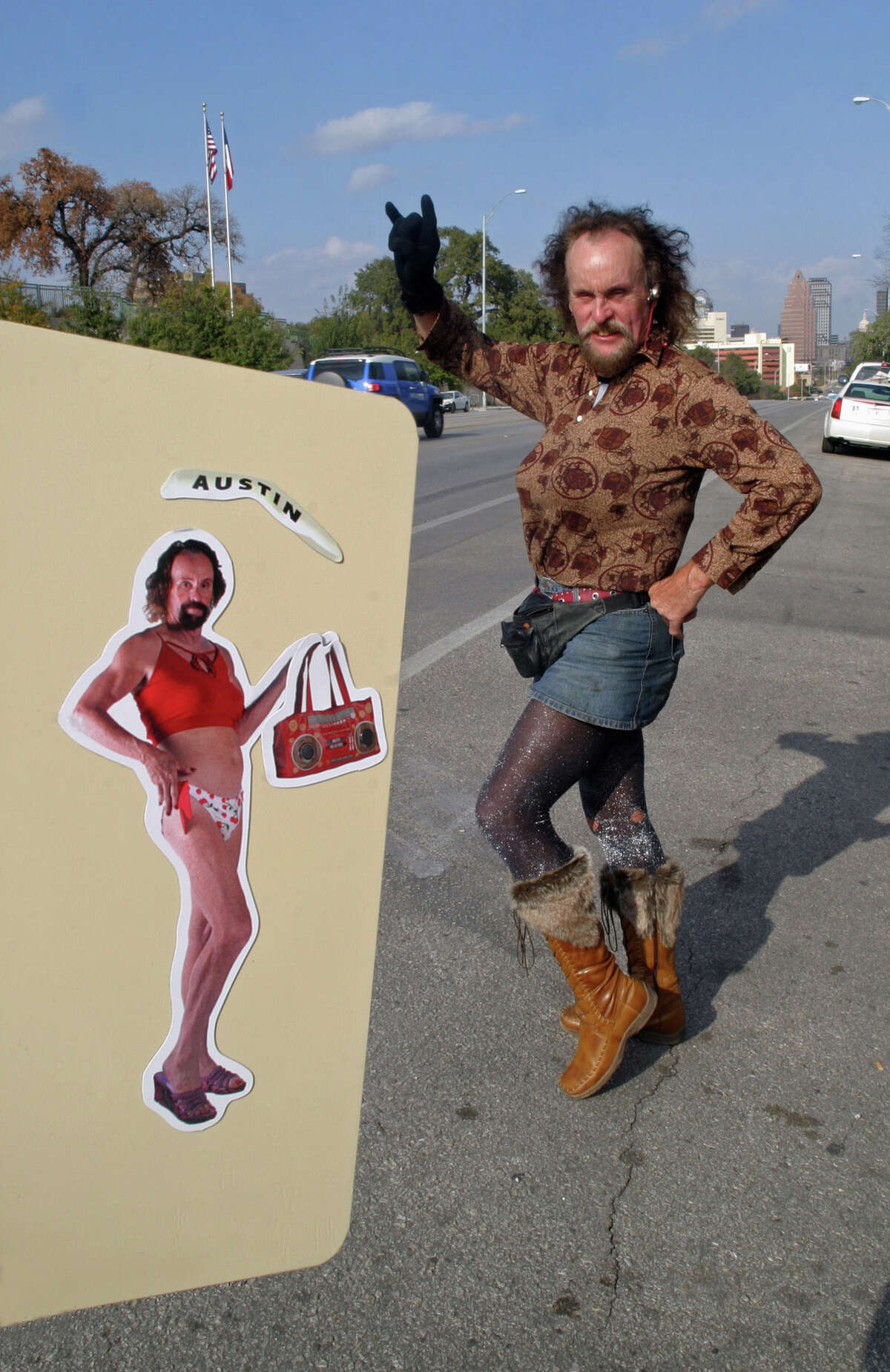 Local homeless, cross dressing personality Leslie Cochran poses with a new refrigerator magnet bearing his likeness along South Congress Ave. in Austin, Texas on Thursday, Dec. 14, 2006. (AP Photo/Jack Plunkett)