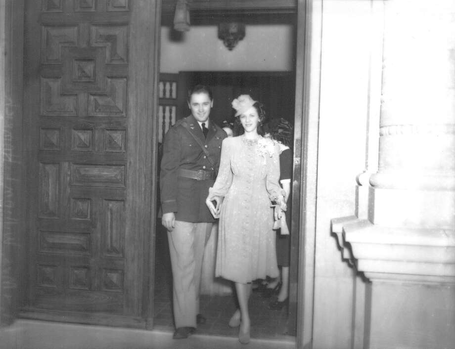 """Lt. and Mrs. William L. Hamrich leave Randolph Field chapel after their marriage,"" said a photo caption in the San Antonio Light March 24, 1940. ""Kelly (Field) grads married hurriedly after graduation will have brief honeymoon before leaving for maneuvers."" Photo: Courtesy UTSA Special Collections / San Antonio Light Collection"