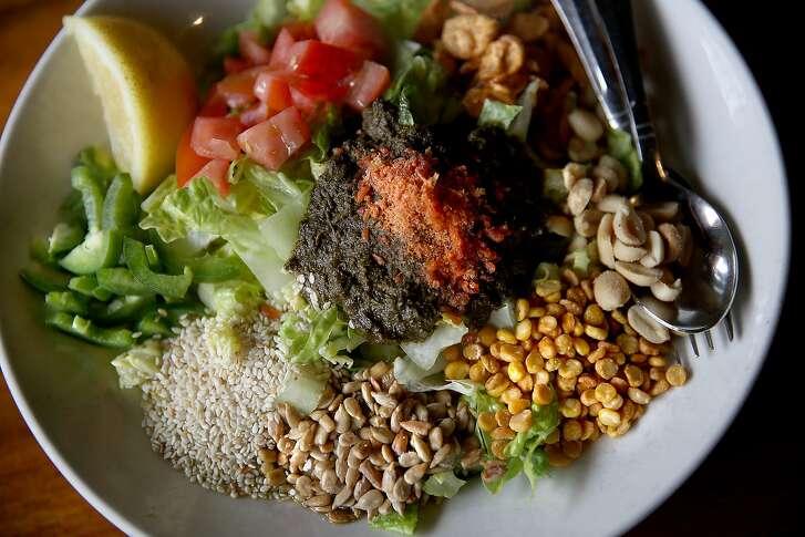 Tea Leaf Salad--fried garlic, peanuts, sunflower seeds, roasted sesame, lemons, tomatoes, romaine lettuce, dried shrimp (or vegetarian)--seen at Burma Superstar in San Francisco, California, on Friday, May 1, 2015.