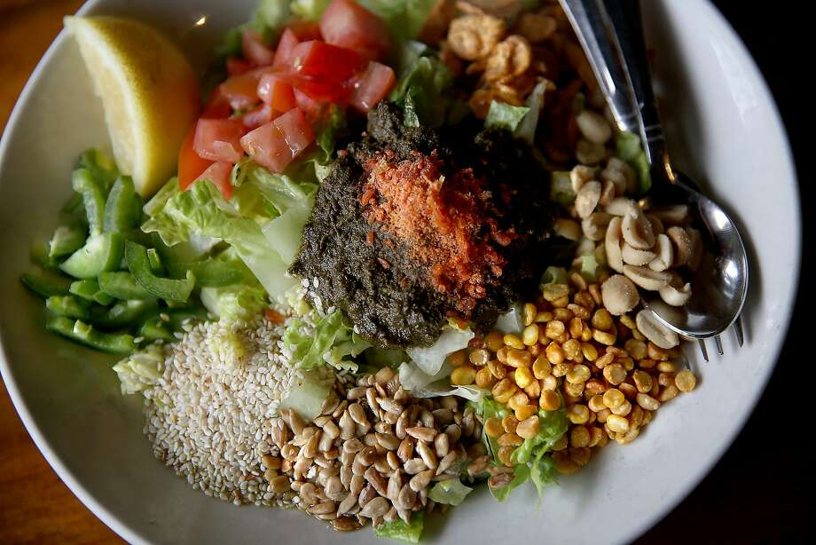 Tea Leaf Salad--fried garlic, peanuts, sunflower seeds, roasted sesame, lemons, tomatoes, romaine lettuce, dried shrimp (or vegetarian)--seen at Burma Superstar in San Francisco, California, on Friday, May 1, 2015. Photo: Liz Hafalia, The Chronicle