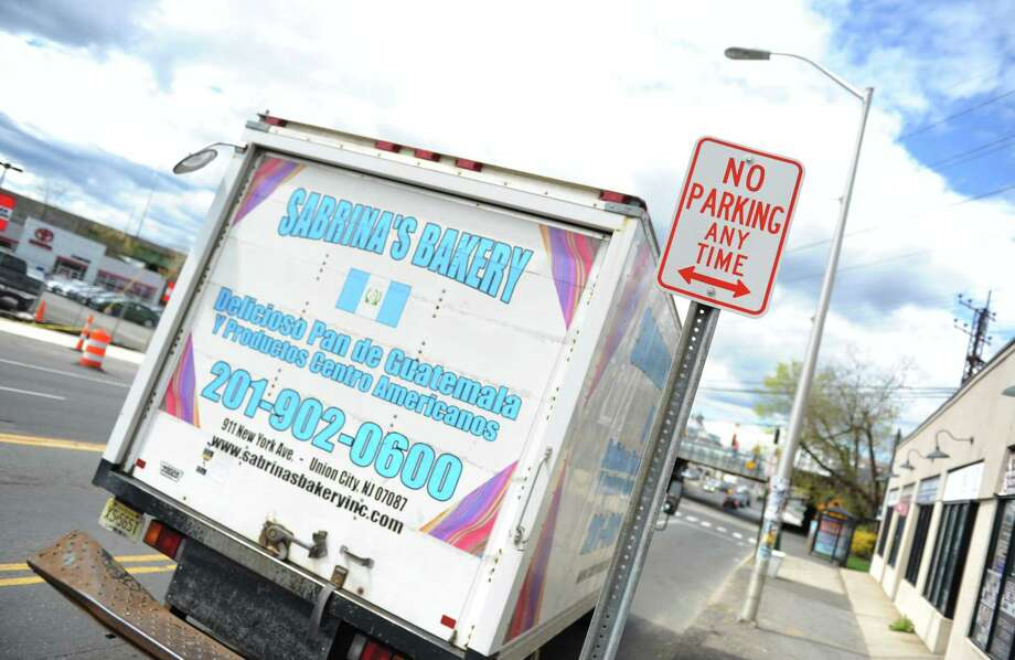 A delivery truck is illegally parked along East Main Street in Stamford, Conn. Monday, April 27, 2015.  A year ago, on-street parking was removed from a stretch of East Main Street to create a two-lane street.  As a result of the parking spaces being removed, local stores along the stretch have lost significant business. Photo: Tyler Sizemore / Greenwich Time