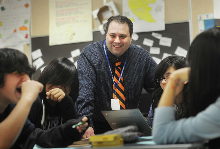 Beard Award winning teacher Gregory Pacific talks with students during one of his eigth grade english classes at Curiale School in Bridgeport, Conn. on Wednesday, April 29, 2015. Photo: Brian A. Pounds / Connecticut Post