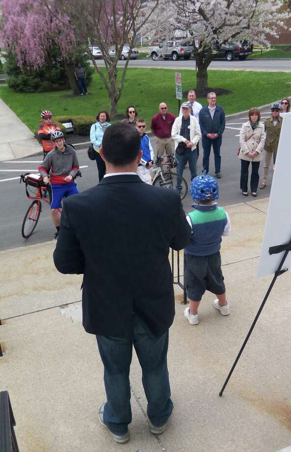 Mayor Ben Blake, accompanied by his blue-helmeted son, Carter, announced to bicycle enthusiasts on Friday, May 1, 2015, that the city is making progress in making its streets more bike-friendly. He made the announcement on the steps of City Hall in Milford, Connecticut. Photo: John Burgeson / Connecticut Post