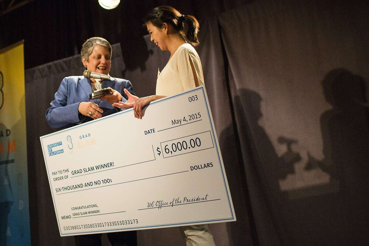 Ashley Fong, a molecular biology and biochemistry graduate student at University of California, Irvine, receives a check and an award from University of California President Janet Napolitano after she was announced as theÊfirst place winner during the inaugural UC Grad Slam at Oakland Marriott City Center in Oakland, Calif. on Monday, May 4, 2015.