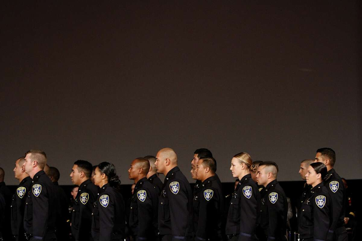Members of the 170th class of Oakland Police Department take their seats for graduation addresses in Oakland, Calif., on Friday, October 31, 2014.