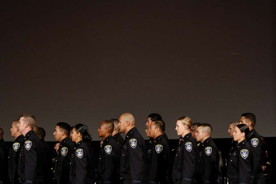 Members of the 170th class of Oakland Police Department take their seats for graduation addresses in Oakland, Calif., on Friday, October 31, 2014. Photo: Sarah Rice, Special To The Chronicle
