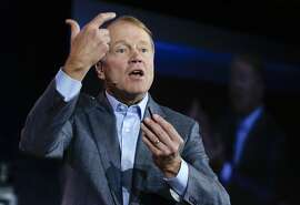 FILE - In this Jan. 7, 2014 file photo, Cisco chairman and CEO John Chambers speaks during a keynote address at the International Consumer Electronics Show, in Las Vegas. Chambers plans to step down after more than 20 years as the CEO of Cisco Systems Inc., the company announced Monday, May 4, 2015. (AP Photo/Julie Jacobson, File)
