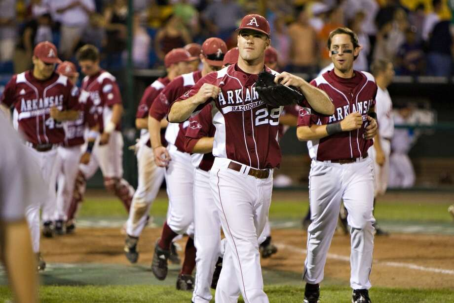 OMAHA, NE - JUNE 17:   Dallas Keuchel of the Arkansas Razorbacks shows off his Arkansas jersey after a game against the Virginia Cavaliers at the College World Series on June 17, 2009 at Rosenblatt Stadium in Omaha, Nebraska.  Arkansas defeated Virginia 4 - 3 in 12 innings.  (Photo by Wesley Hitt/Getty Images) Photo: Getty Images