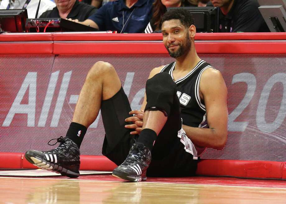Tim Duncan of the San Antonio Spurs as he sits by the scorer's table waiting to enter the game against the Los Angeles Clippers during Game 7 of the Western Conference quarterfinals. Photo: Stephen Dunn /Getty Images / 2015 Getty Images