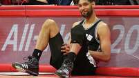 Tim Duncan of the San Antonio Spurs as he sits by the scorer's table waiting to enter the game against the Los Angeles Clippers during Game 7 of the Western Conference quarterfinals.