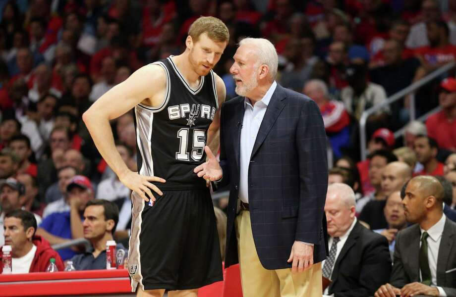 Spurs coach Gregg Popovich converses with Matt Bonner as they play the Los Angeles Clippers during Game 5 of the Western Conference quarterfinals. Photo: Stephen Dunn /Getty Images / 2015 Getty Images