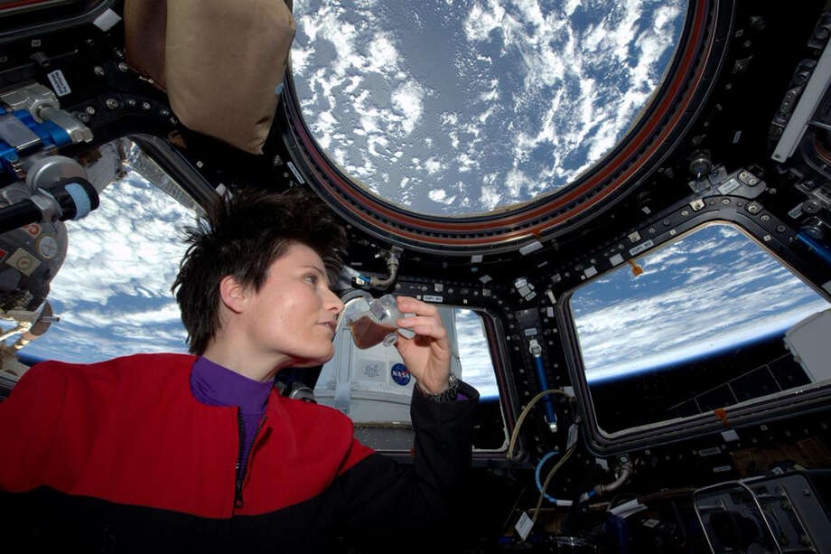 In  a photo posted on Twitter   and provided by NASA, Italian astronaut Samantha Cristoforetti sips espresso from a cup designed for use in zero-gravity on the International Space Station. Cristoforetti is the first Italian woman in space. Photo: / Associated Press / NASA
