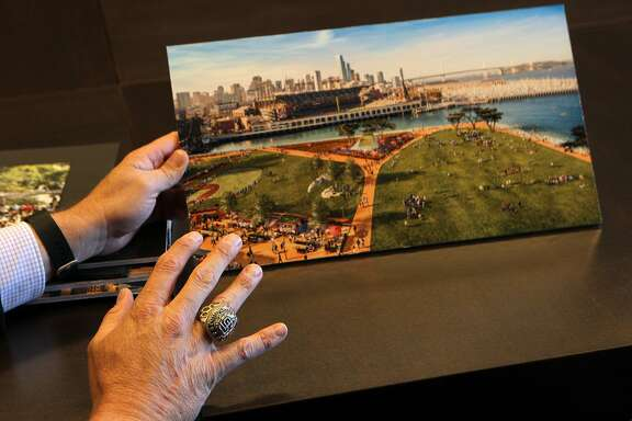 Giants vice president Jack Bair points to an artist's rendition of the proposed development for Lot A, Monday, May 4, 2015, in San Francisco, Calif.