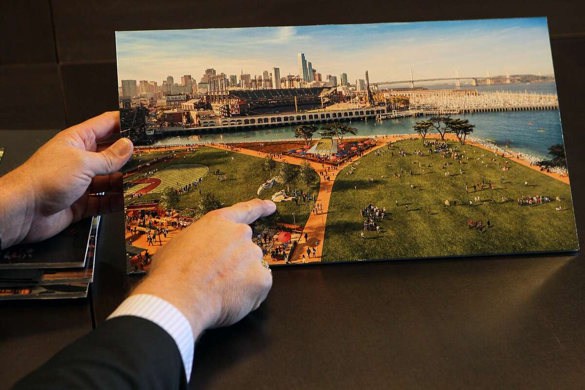 Giants vice president Jack Bair and director of development points to an artist's rendition of the proposed development for Lot A, Monday, May 4, 2015, in San Francisco, Calif.