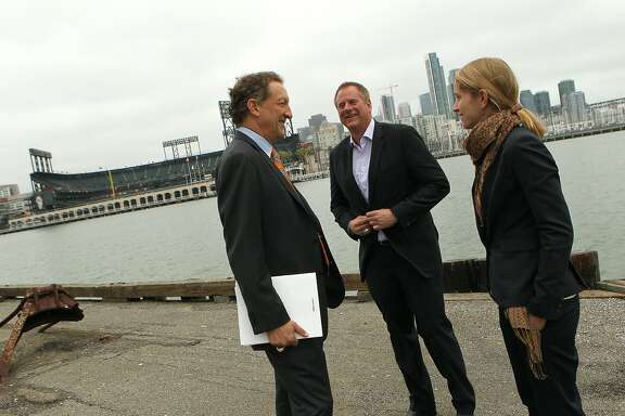 (L-R) Giants CEO Larry Baer, vice president Jack Bair and director of development Fran Weld talk about the proposed development for Lot A, Monday, May 4, 2015, in San Francisco, Calif.