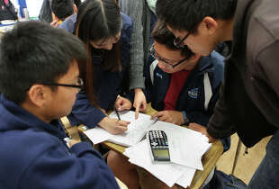 (Clockwise) Steven Chen, 17, Hilda Liu, 17, Gordon Mah, 17, and James Lew, 18, study for their AP calculus exam at Wallenberg High School in San Francisco, Calif., on Monday, May 4, 2015. Wallenberg encourages students to do well in math and sciences for their college applications.