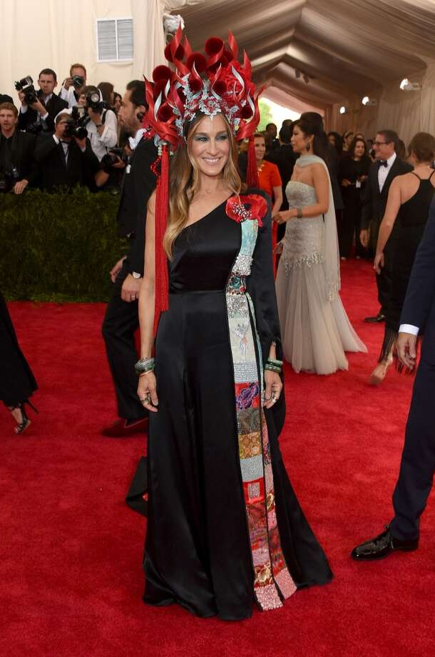 Sarah Jessica Parker. Girl on fire, indeed. The fashion-forward actress takes a misstep with this look. The black, satiny, one-shouldered gown could be pretty, but we're too distracted by the Philip Treacy-designed flaming monstrosity on top of her head to tell.