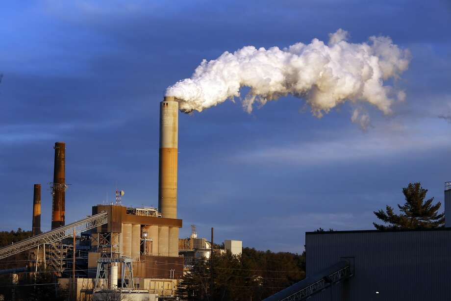 Steam billows from the coal-fired Merrimack Station in Bow, N.H. The plan to cut emissions is expected to face legal challenges and opposition in Congress. Photo: Jim Cole, Associated Press