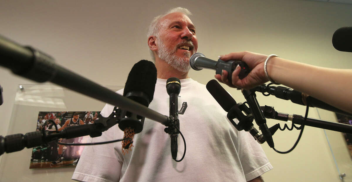 San Antonio Spurs coach Gregg Popovich (center) speaks with the media Monday May 4, 2015 at the Spurs' practice facility about last season and the upcoming offseason.