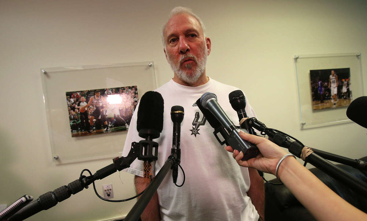 San Antonio Spurs coach Gregg Popovich (right) speaks with the media Monday May 4, 2015 at the Spurs' practice facility about last season and the upcoming offseason.